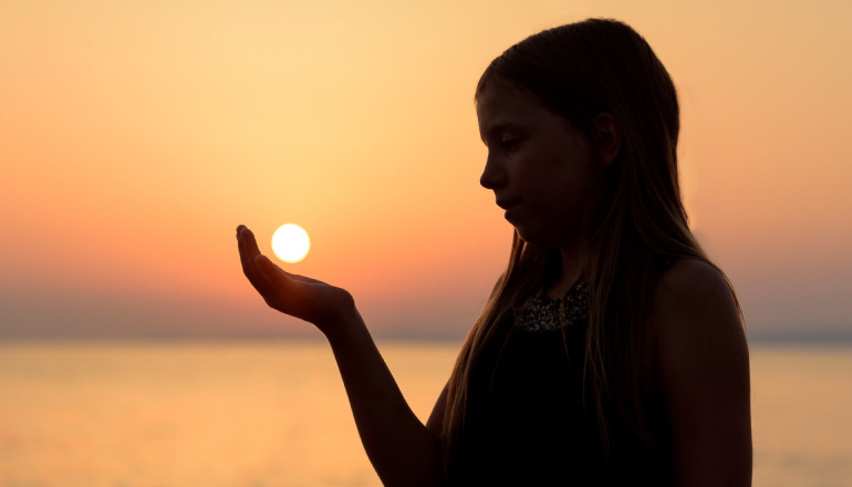 girl holding the sun